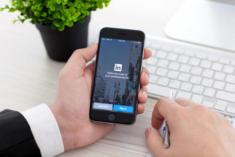Businessman using LinkedIn app